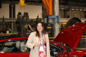 Barbara Albert in front of a Tesla car smallres